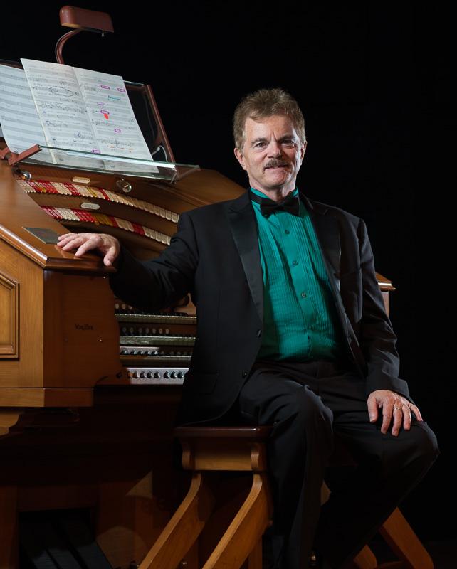 Theater Pipe Organist, and silent fil accompaniest Clark Wilson sitting at the Manasota Theatre Organ Society Forker Memorial Wurlitzer in Sarasota Florida